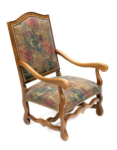 A pair of Louis XIV style oak armchairs