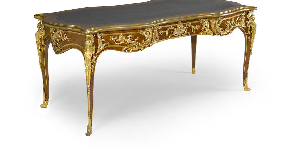 A fine Louis XV style mahogany gilt bronze mounted bureau plat<BR />late 19th century