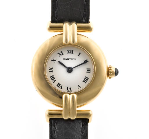 An eighteen karat gold wristwatch with black leather strap, Cartier