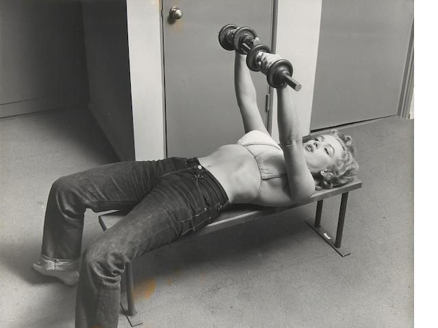 Philippe Halsman (American, 1906-1979); Marilyn Monroe Lifting Barbells;