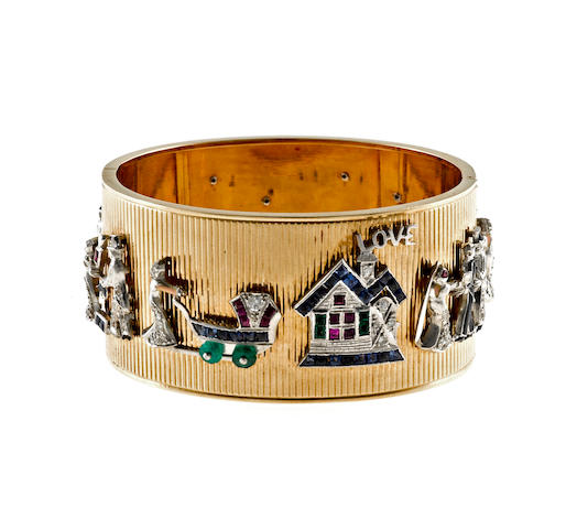 A diamond, synthetic gem, enamel and fourteen karat bicolor gold bangle charm bracelet