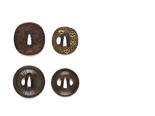 Heianjo Iron tsuba with waves and water wheels in brass inlay; Saotome tsuba with spokes and brass inlay (condition); Iron mon-zukashi tsuba; Iron Saotome tsuba with spokes