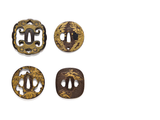 Iron Shoami tsuba with mon design and brass overlay, with Kenjo iron tsuba with plaintains and clouds apertures, Shoami-school iron tsuba with bushy tailed tortoises in gold inlays, Iron tsuba with gold fan and matsukawabishi gold designs, gold inlays on the rim