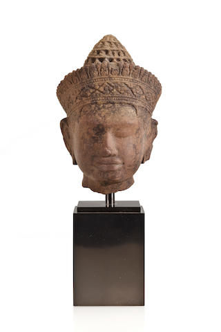 A sandstone head of a divinity Cambodia, Khmer, 10th Century