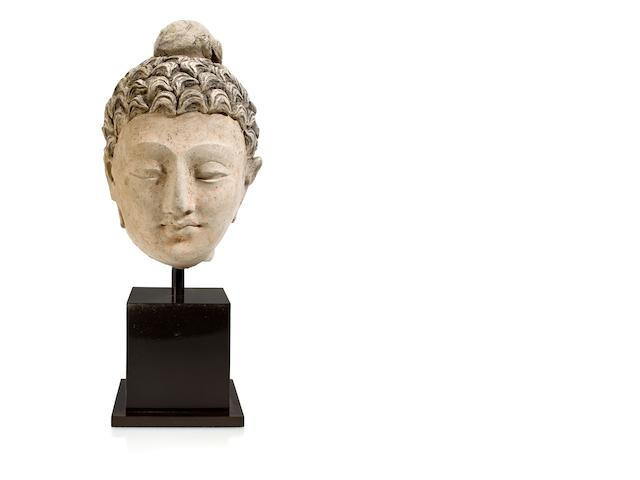A polychrome clay head of Buddha Gandhara, 4th/5th Century