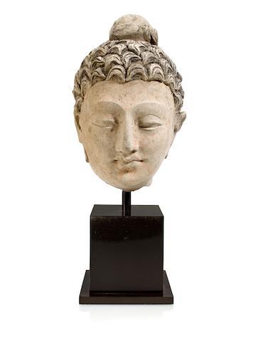 A polychrome clay head of Buddha Gandhara, 4th/5th Century