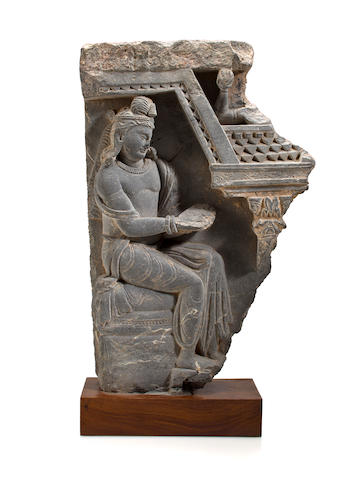 A gray schist relief panel of a bodhisattva, possibly Maitreya Gandharan, 3rd/4th century