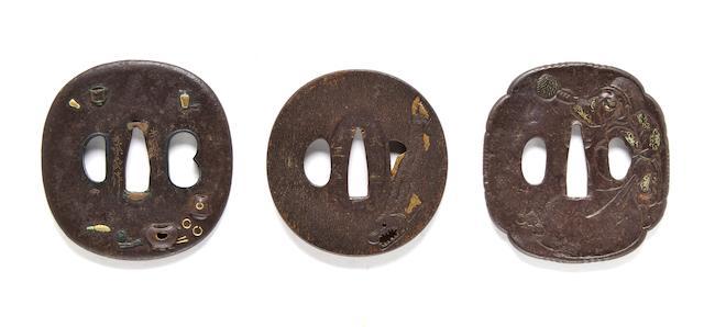 Iron tsuba with tea utensils, sig. Bushu ju Nara saku; Bushu school iron tsuba with fish design, signed Masahisa; Iron tsuba with Daikoku