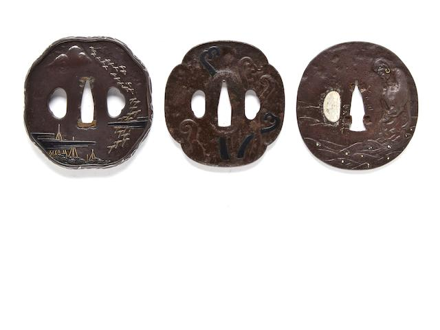 Nara school iron tsuba with fishing nets and a flock of geese, silver vines on rim; Nara school iron tsuba with ferns in iron and shakudo; Iron tsuba with Daruma on a lotus leaf, illegibly signed Mito ju le.