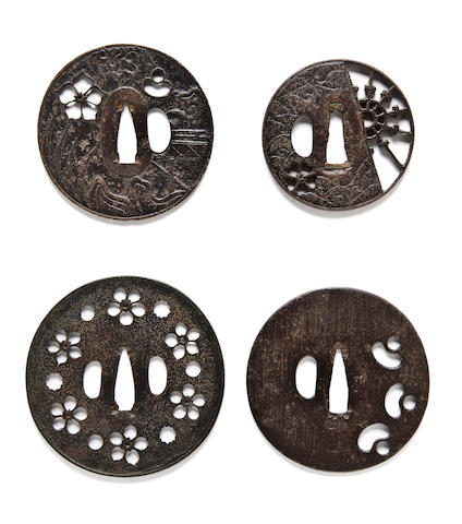 Four early iron sukashi tsuba 15th-16th century