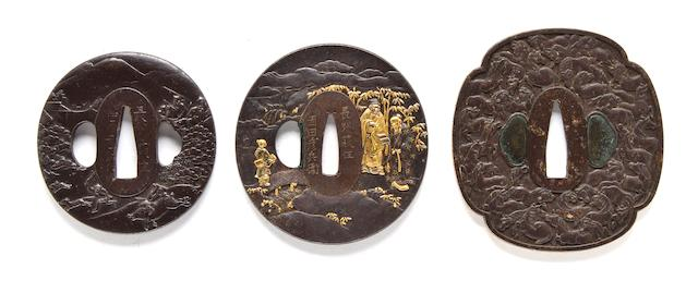 Iron tsuba with boar hunt, signed Choshu Hagi ju Nakahara Yukihisa saku; Iron tsuba with sages in gold and shakudo, signed Choshu Hagi ju Okada Hikobei Masatomi; Shakudo and gold tsuba with scholars signed Masatomo (condition); Mokko-gata iron tsuba with horses and keyfret design in gold on rim