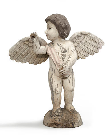 A Spanish Colonial later painted figure of a cherub<BR />19th century