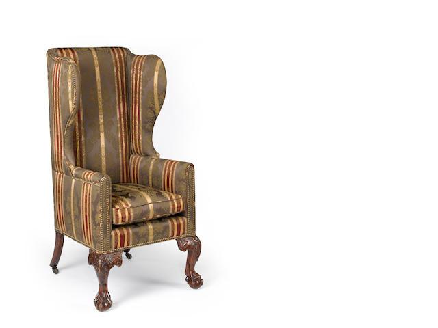 An unusual George III mahogany wing chair