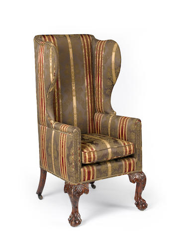 An unusual George III mahogany wing chair