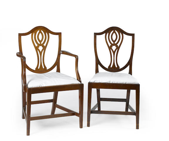 A set of twelve George III style mahogany dining chairs second half 19th century