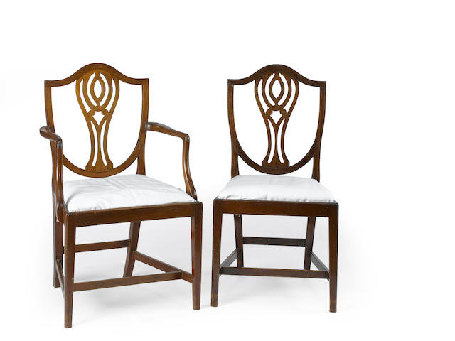 A set of twelve George III style mahogany dining chairs<BR />second half 19th century