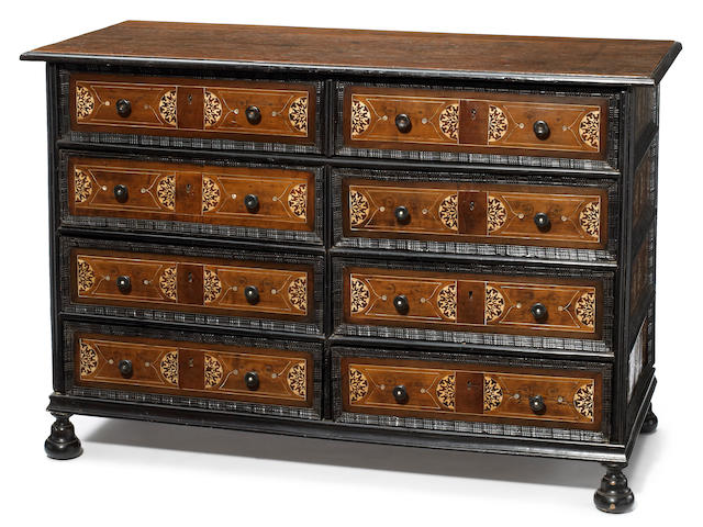 An Italian Baroque ivory inlaid walnut parcel ebonized chest <BR />late 17th century