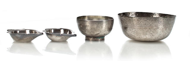 Two silver ritual bowls and two votive dishes Java 15th-17th, century