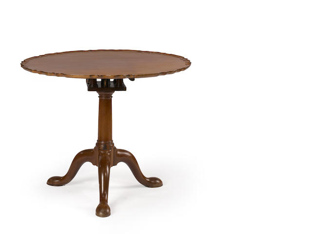 A George III mahogany pie crust tilt top table