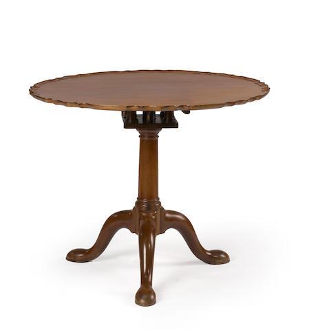 A George III mahogany pie crust tilt top table