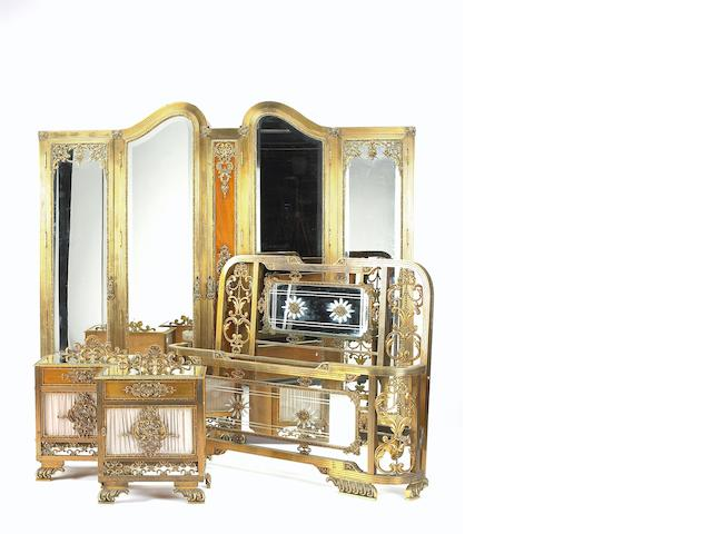 A Louis XVI style brass mounted mahogany bedroom suite<BR />first quarter 20th century