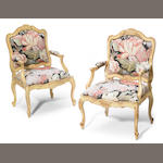 A pair of Louis XV style paint decorated fauteuils