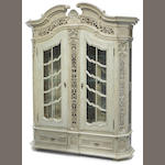 A Continental Baroque style paint decorated display cabinet