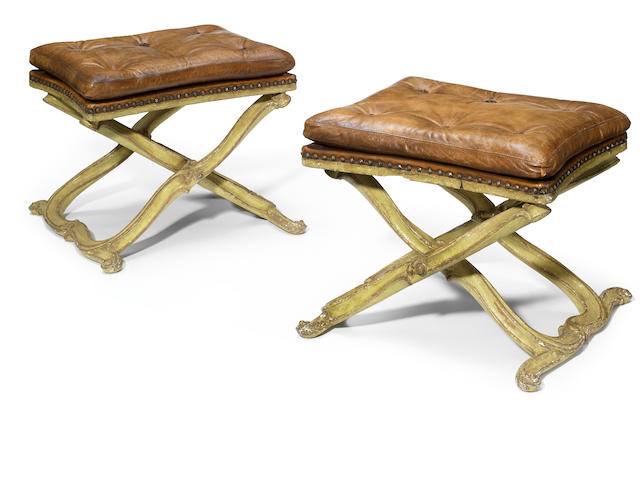 A pair of Continental Rococo paint decorated stools <BR />mid 18th century