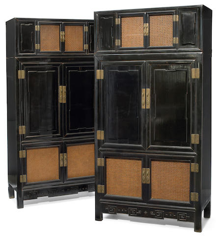 A pair of Chinese brass mounted cane paneled ebonized cabinets