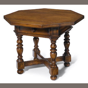 An Italian Baroque style mixed wood octagonal center table