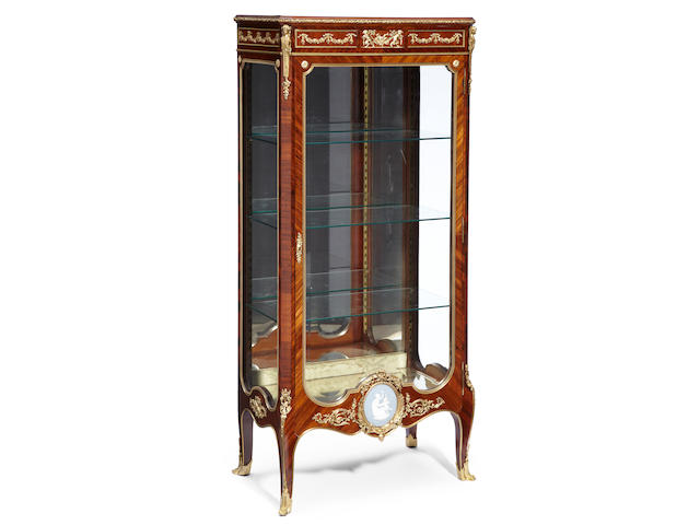 A Louis XVI style gilt bronze mounted kingwood vitrine <BR />late 19th century