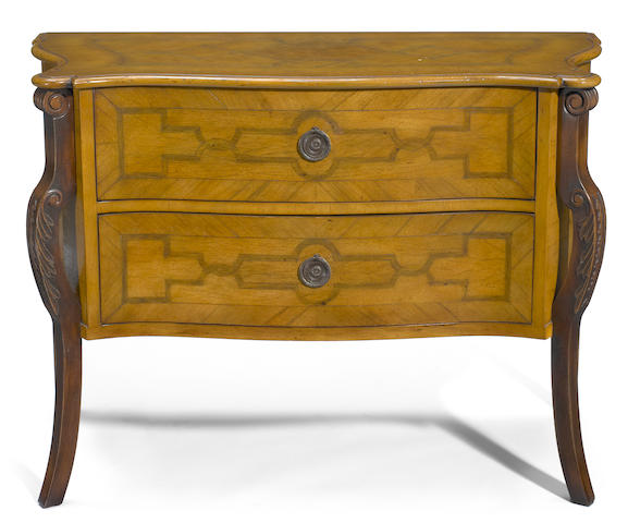 A Continental Rococo style mixed wood chest