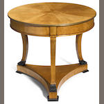 A Biedermeier style parcel ebonized ash center table