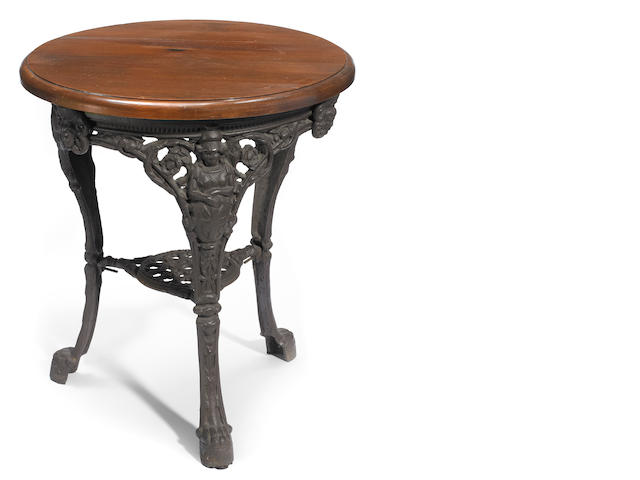 A Renaissance Revival cast stone and oak table