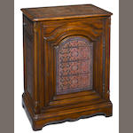 A Louis XV style paint decorated carved hardwood side cupboard