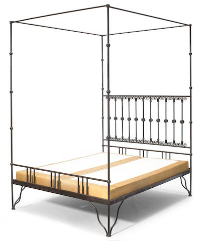 A Contemporary patinated metal four poster bed