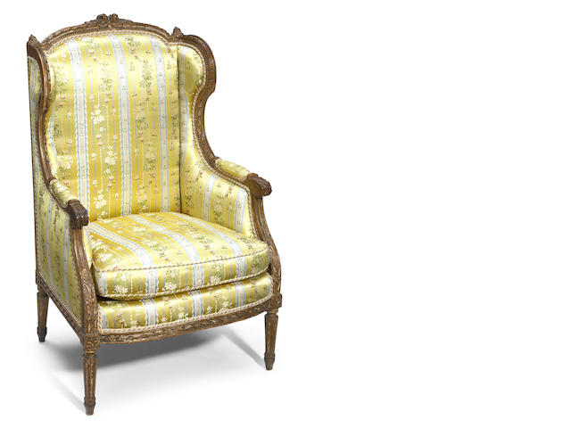 A Louis XV style satin upholstered oak fauteuil