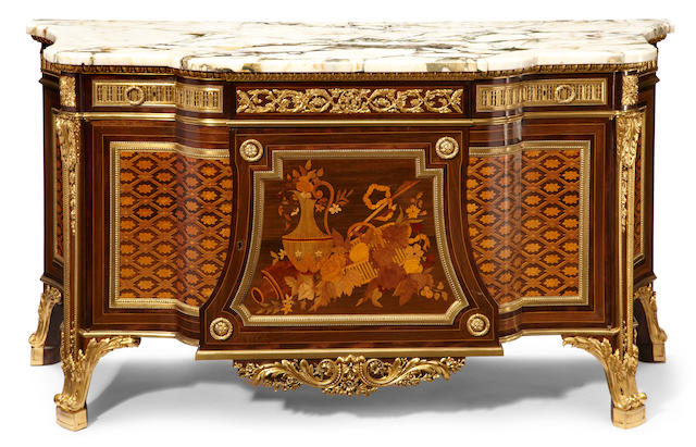 A Louis XVI style gilt bronze mounted marquetry inlaid commode <BR />after a model by Jean Henri Riesener <BR />late 19th century