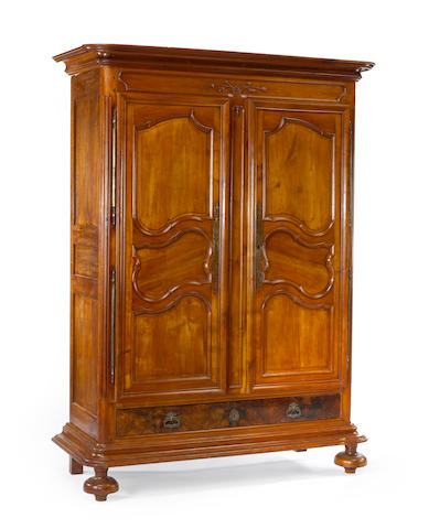 A late Louis XIV walnut armoire<BR />early 18th century