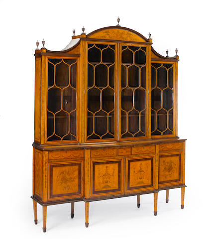 A fine George III style marquetry and satinwood breakfront cabinet  late 19th century
