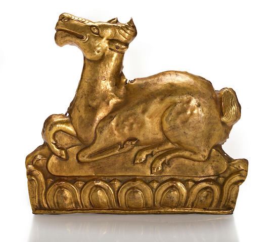 A gilt copper repoussé plaque of a deer Tibet, 18th/19th century