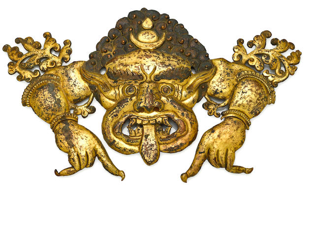 A gilt copper repousse plaque of a Kirrtimukhara Tibet, 18th/19th century