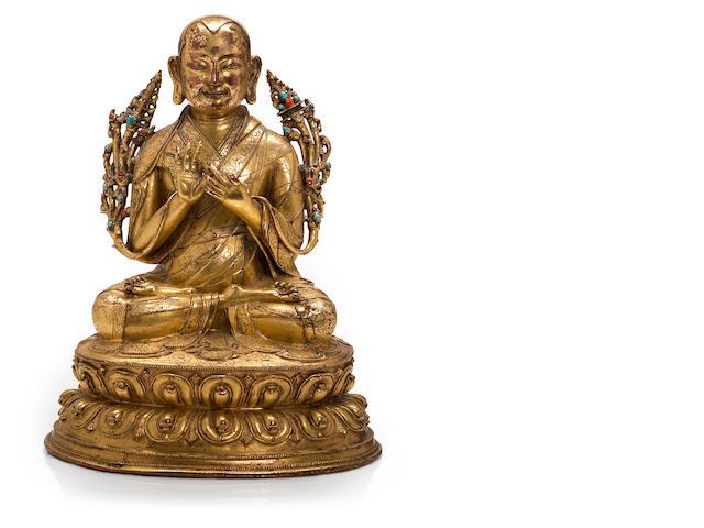 A gilt copper alloy portrait of a lama Tibet, 16th century