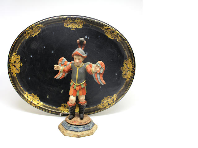 An English papier-mâché gilt stencilled  oval tray and a Spanish colonial carved and polychrome figure of an archangel 19th century