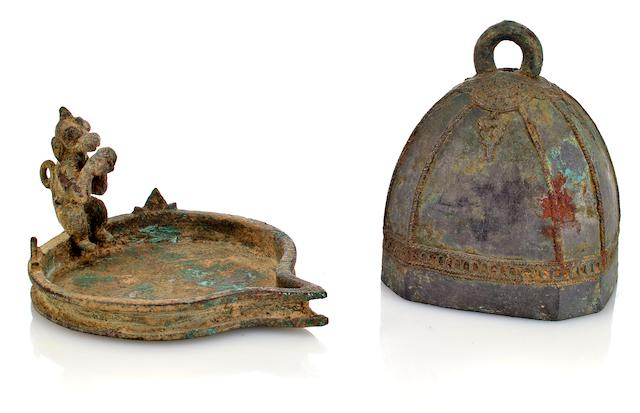 A bronze oil lamp and bell South India, 15th centuy and Java, 12th century
