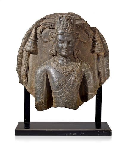 A black stone bust of Buddha Eastern India, Bihar, 11th century