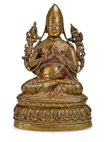 A gilt copper alloy figure of Tsong Khapa Tibet, 15th century