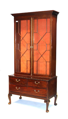 A George III mahogany bookcase cabinet composed of antique elements