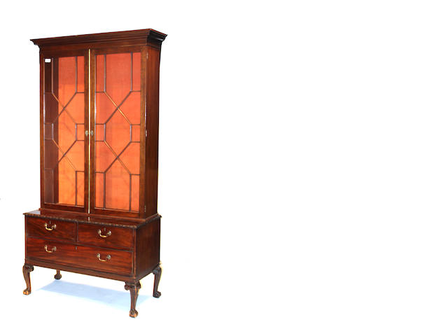 A George III mahogany glazed door cabinet on short cabrio legs composed of antique elements