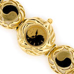An eighteen karat gold and black onyx integral bracelet wristwatch, Gage